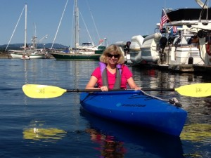 Jill kayaking in the Friday Harbor marina.