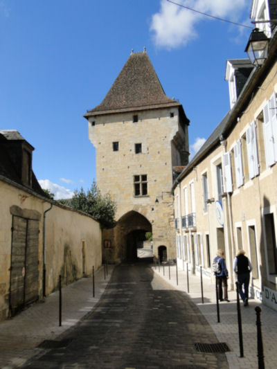 Shopping in Nevers under the shadow of the old city gate