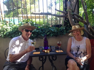 Henry Warner and Jill Lehman wearing our Van Gogh hats while enjoying a wine on the patio