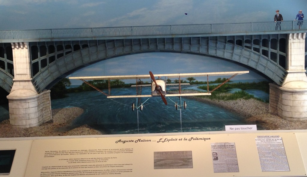 Scaled model of Auguste Maïcon flying his plane under the Nice bridge