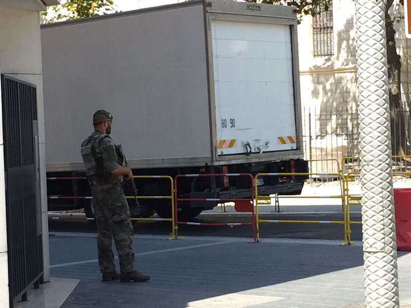 After the terrorist attack in Nice, armed guards were seen routinely.  To enter a department of grocery store, bags and backpacks had to be examined.